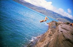 """TO DO: CLIFF JUMPING. HAWAII has some of the best cliff diving spots incluide Ka Lae, or South Point, on the Big Island, and Waimea Bay on Oahu. Both attract audacious """"freejumpers"""" throughout the long and busy summer season."""