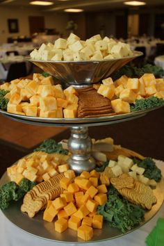 Tiered stand to display assorted cheese cubes and crackers for a summer wedding reception. Hi-Lo Restaurant and Catering. www.hiloclub.com: