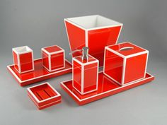 """Pacific Connections - Red with White Lacquer Bath Collection  Red with White Trims Lacquer Bath Collection Item List: L-29RWH: 3""""x3""""x4.5""""H Brush Holder L-57RWH: 3""""x3""""x8""""H Lotion Pump L-62RWH: 5.5"""" Cube Tissue Box Cover L-63RWH: 9""""x9""""x10""""H Waste Basket L-64RWH: 12""""x8""""x1.5""""H Vanity Tray L-66RWH: 4""""x5""""x1.5""""H Soap Dish L-86RWH: 3.5""""x3.5""""x4""""H Q Tip Box L-87RWH: 17""""x7"""" Long Vanity Tray"""