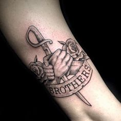 Shaking hands brothers with roses and dagger. Style: Black and Gray. Color: Gray. Tags: Creative, Awesome, Brother