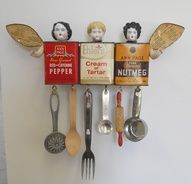 This is so cute.  Recycled spice tins, doll parts and kitchen tools.  Don't you love it?