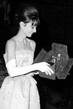 Audrey Hepburn after winning the David di Donatello Award for Best Foreign Actress in 1960. The David di Donatello Award is the Italian equivalent of an Oscar, and Audrey won all three awards she was nominated for: The Nun's Story, Breakfast at Tiffany's, and My Fair Lady.