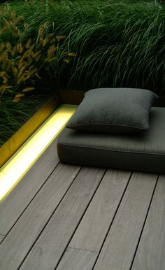 Wooden terrace with integrated lighting cove. Landscape design by Vitalis.