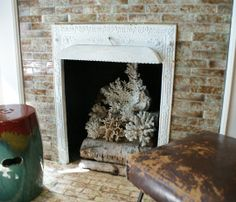This is a neat idea for filling a non-functional fireplace.