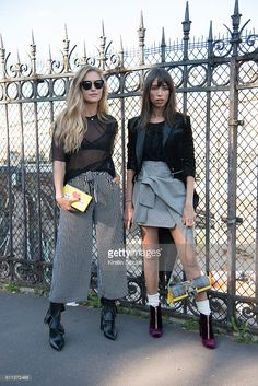 Fashion blogger Maja Malnar wears an Alexander Wang top, Topshop trousers, Fendi sunglasses and J.W. Anderson shoes with Fashion blogger Thania Peck who wears Zara skirt, Mango blazer, Dune shoes and Ella McHugh bag on day 2 of Paris Womens Fashion Week Spring/Summer 2017, on September 28, 2016 in Paris, France.