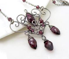 Dark red garnet necklace, wire wrap jewelry, handmade garnet sterling silver necklace, garnet jewelry, gothic jewelry. $175.00, via Etsy.