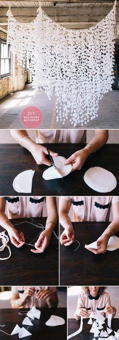 A wax paper backdrop, paper pom poms, paper dahlia wreath, tassel garland and more!  #paper #wedding #weddingstyle #weddingdiydecor