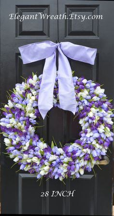 What a way to welcome spring! This large wreath is perfect for your front door or large indoor space such as over a mantle or foyer. Measures 28