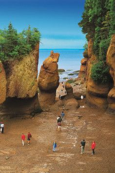 """The Bay of Fundy is a bay on the Atlantic coast of North America, on the northeast end of the Gulf of Maine between the Canadian provinces of New Brunswick and Nova Scotia, with a small portion touching the U.S. state of Maine. Some sources believe the name """"Fundy"""" is a corruption of the French word """"Fendu"""", meaning """"split"""", while others believe it comes from the Portuguese fondo, meaning """"funnel""""."""