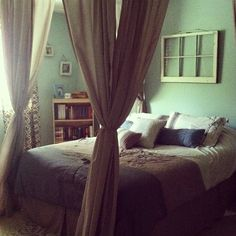 small apartment decor. actually had that bedspread. love the faux-canopy look.