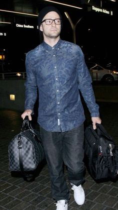 Justin Timberlake looking sharp while travelling. Top button done up in his Indigo Pique Scotch & Soda shirt.