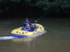 Military Surviving Trek Maidstone, Kent, UK. Crossing the river with rope.