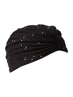 Sparkles? Turban? Paging Joan Collins.