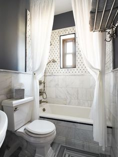 contemporary white & gray bathroom with two extra long shower curtains hung close to the ceiling making the bathroom look HUGE! Beautiful Bathroom Inspiration: Contemporary Shower Curtain Ideas from Bathroom Bliss by Rotator Rod Grey Bathrooms, Beautiful Bathrooms, Small Bathroom, White Bathroom, Bathroom Ideas, Bathroom Basin, Bathroom Cabinets, Bathroom Vanities, Bathroom Designs