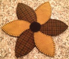 "Primitive Wool Penny Rug Votive Candle Mat Mug Rug Pinwheel Flower | eBay.  January 2013 starting at $17 total.  All wool.  All handmade by my fav eBay penny rugger rosemarie0506.  8"" at widest points."