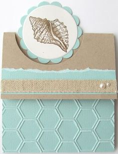 This card features Stampin' Up! products:   By the Tide Stamp Set, Pool Party Core'dinations Card Stock, Natural Trim Ribbon, and Honeycomb Embossing Folder.  It was created by Rachel Tessman.