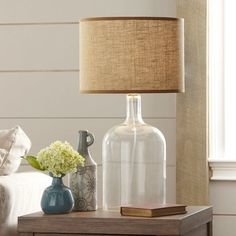 How to make a lamp! This post explains how to make a lamp with an old glass water jug but you can make a lamp out of anything! Come see the DIY! Glass Water Jug, Clear Glass, Diy Bottle Lamp, Farmhouse Table Lamps, Diy Table Lamps, Farmhouse Decor, Make A Lamp, Lamp Makeover, Room Lamp
