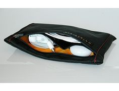 SF Bags Cableguy - holds just about any tech or other supplies you need.    http://www.sfbags.com/products/cableguy/cableguy.htm