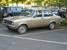 Ford Escort MKII (1974 to 1980) A friend I used to work with's father gifted him with this type of car only in a navy blue. Got jealous every time he would pull up beside me in the parking lot.