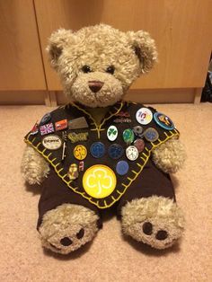 Make a teddy bear sized camp blanket to display guiding pin badges on