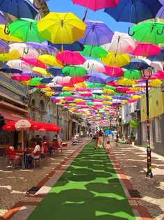 """When travel to Portugal, you can not miss the city of Aveiro The city held a big festival in July - the AgitÁgueda - known in the world through its urban art facilities.""  Agueda teems with color and joy of living! The Umbrella Sky Project has become a global success and the images ... #Portugal"