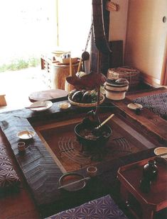 I've always liked the thought of living in an old Japanese house, open hearth