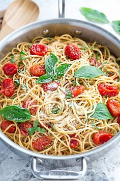 Cherry Tomato Basil Spinach and Parmesan Pasta makes the perfect easy and comforting weeknight meal! Best of all, it comes together easily in under 30 minutes!