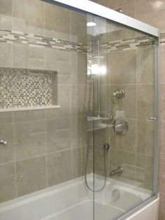 Love this tub...tile, accents, and doors. This would work for your bathroom, window would be where the indent is