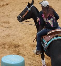 Barrel racing with Country Life Outfitters Apparel. Featured is our Black and Pink Skull Long Sleeve T.  www.countrylifeoutfitters.com