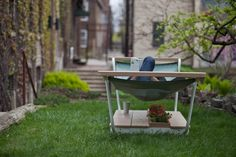 Genius: a hammock stand with an integrated bench, flower planter, and storage.
