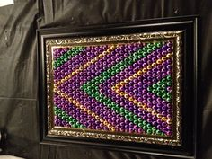 My Inspiration creation of bead art with mardi gras beads!