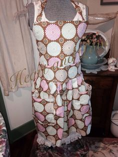 A personal favorite from my Etsy shop https://www.etsy.com/listing/227342214/womens-retro-large-polka-dot-apron