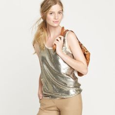 J. Crew // Sequin Shell - ivory, gold Shine bright like a diamond in this Sequin Shell by J. Crew. Gold rustic sequins on an ivory cotton fabric is the perfect top under a black edgy leather moto jacket. Worn a few times but still in good condition. Sequins are intact but there are some strings detached. Sheer Silk back. J. Crew Tops Blouses