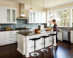 dark floor, white cabinets, dark counters - dark wood floor kitchen - eatwell101.com