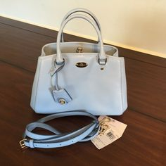 Light Blue Coach Purse Only used about a week. Color is too light for me. Also have matching wallet I could bundle. Coach Bags