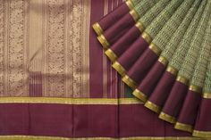 Dark green and maroon shades Kanjivaram silk Saree