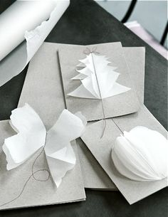 DIY christmas cards:  layers of cut tissue paper stitched onto cardboard