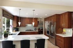 Kitchen Interior Breathtaking U Shaped Kitchen With Breakfast Bar And White Countertop Also Laminated Wood Cabinet Along With Big Silver Refrigerator Wonderful U Shaped Kitchen Design Ideas