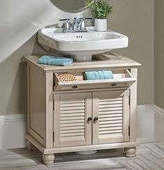 Home Depot has a cabinet that fits around a pedestal sink I so
