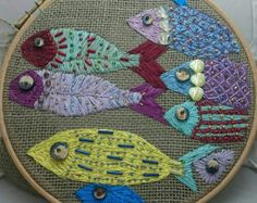 Colourful fish embroidery framed in hoop