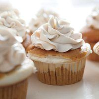 Cheesecake-Filled Pumpkin Cupcakes | http://www.rachaelraymag.com/recipes/rachael-ray-magazine-recipe-search/dessert-recipes/cheesecake-filled-pumpkin-cupcakes
