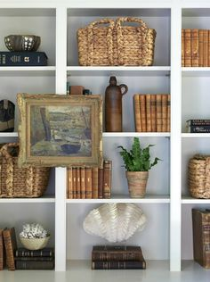 Sarah Bartholomew | beautiful bookcase sytling. I love the look of hanging small art on the bookcase to break things up.