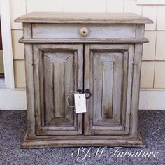 Painted in grey chalk paint, distressed and waxed on dark wax. End table by SJM Furniture