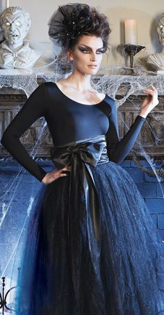 You'll be the belle of every ball, dressed in a skirt layered with glittering black tulle topped with a removable black satin ribbon sash.