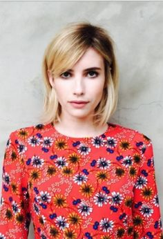 Who made  Emma Roberts' floral long sleeve dress?