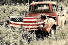 I love the flag on the back of this old truck, along with the wild flowers and the lasso!