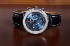 With a dial as blue as the sky, the Breitling Navitimer 01 (Ref. AB012721.C889.747P.A20D.1) is an absolute archetype of a pilot's watch and evokes adventures above the clouds and the sheer infinite freedom of flying. Breitling Navitimer, Breitling Watches, Infinite, Omega Watch, Freedom, Clouds, Luxury, Leather, Blue