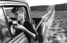 An image taken by celebrated documentary photographer Larry Towell of his wife Ann holding a wild pear to the mouth of their son, Moses in 1983.