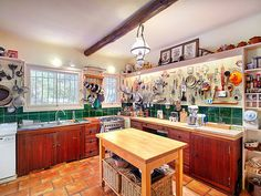 Julia Child's French Vacation Home Is For Sale: See the Gorgeous Photos | THE KITCHEN | Considered the most important room in the house, Child's husband designed the kitchen, which is a smaller replica of the one they shared in their Cambridge, Massachusetts home.