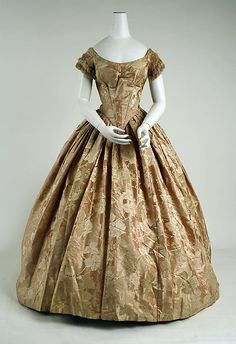 ~Light brown and green printed silk evening gown, circa 1857. Metropolitan Museum of Art~